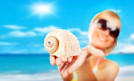 happy girl with seashell selective focus photo