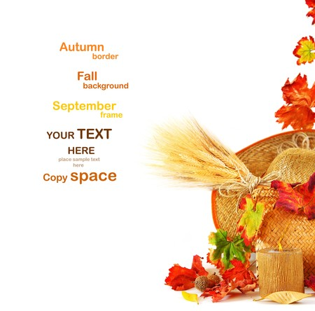 Autumn leaves border with candle & wheat isolated on white Stock Photo - 7610384