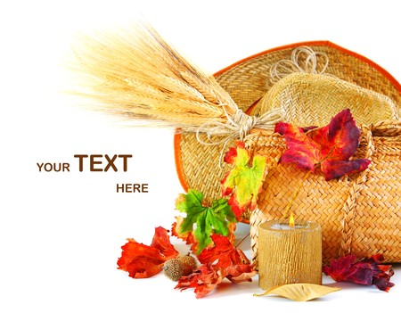 Autumn leaves border with candle & wheat isolated on white Stock Photo - 7665009