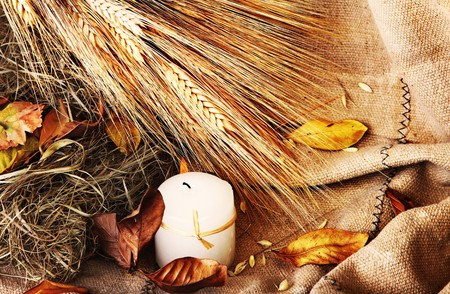 Grunge wheat background with autumn leaves & candle Stock Photo - 7665015