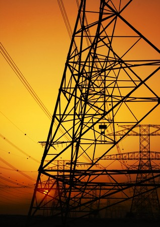 Electricity Pylon over orange sunset sky. Environmental damage Stock Photo - 7665002
