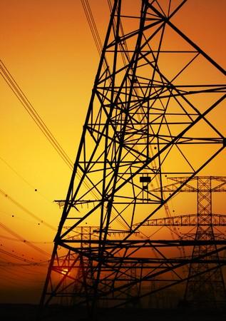 Electricity Pylon over orange sunset sky. Environmental damage Stock Photo - 7665002