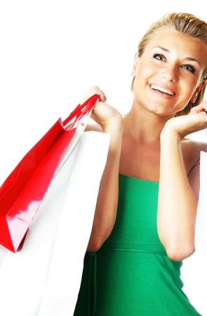 Happy shopping girl carrying new bags photo
