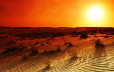 Extreme desert landscape with orange sunset photo