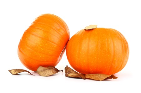 Two fresh pumpkins isolated on white with dry leaves photo