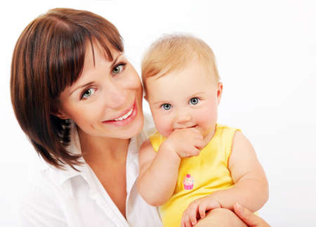 Portrait of a smiling mother & baby isolated over white background photo