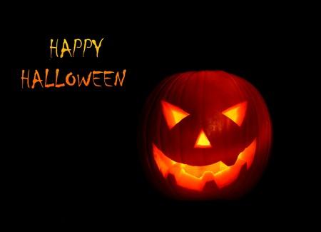 pumpkin head: Glowing Halloween pumpkin isolated on black