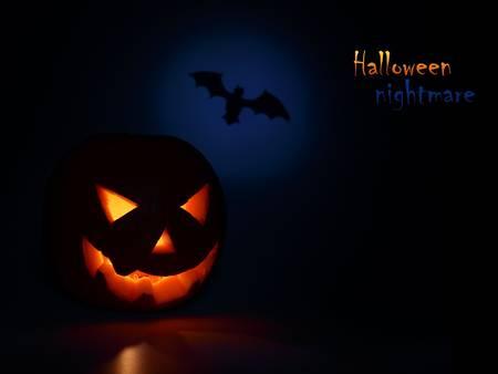 Halloween nightmare with glowing head & bat photo