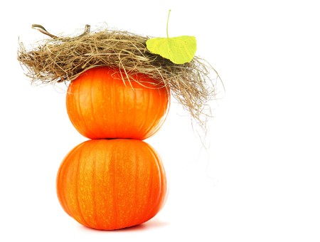 Pumpkins & dry leaves isolated on white photo