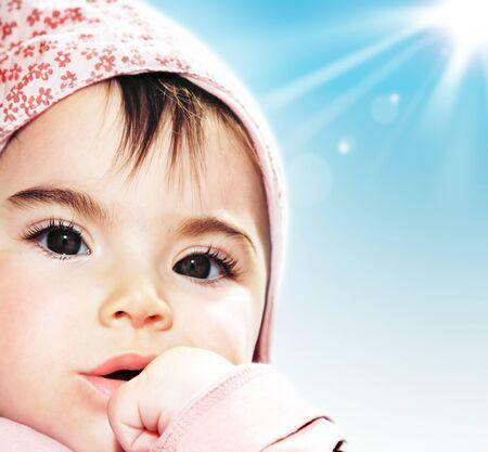 Little girl closeup portrait over blue sky Stock Photo - 7842043