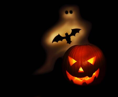 Halloween pumpkin bat and chost isolated on black background Stock Photo - 7948389