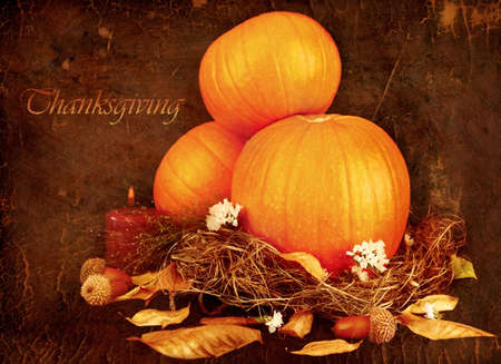Thanksgiving holiday greeting card with orange gourds & candle photo