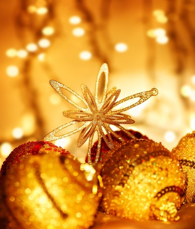 Christmas decoration, holiday background with golden lights photo