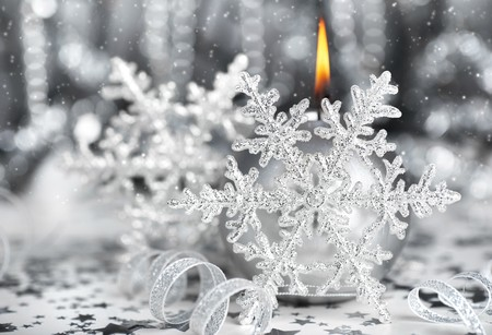 Christmas decoration, silver holiday background with candle & snowflake photo