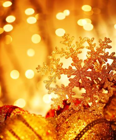 Golden Christmas tree ornament and holiday decoration with snowflake & blur lights Stock Photo - 8184120