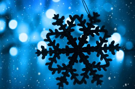 Blue snowy Christmas holiday background with tree decoration snowflake ornament and bokeh lights Stock Photo - 8184105