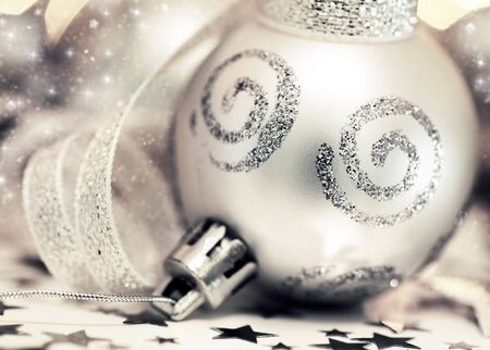 Holiday background with silver Christmas tree ornament and decoration photo