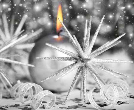 Silver holiday background with candle and Christmas tree ornament and decoration photo