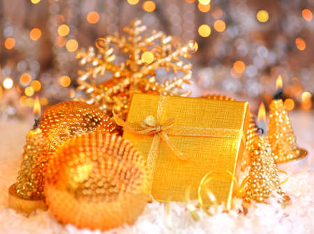 Winter holiday background with golden present gift box, Christmas tree ornament  & candle decoration Stock Photo - 8267500