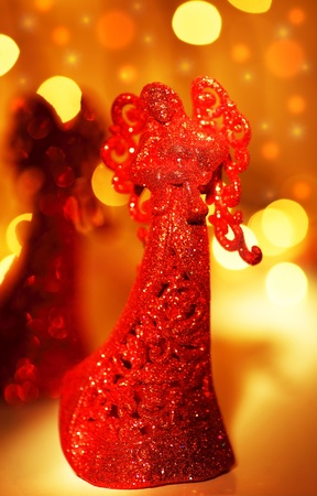 Red angel Christmas tree ornament, holiday background with defocus lights and decoration Stock Photo - 8267521
