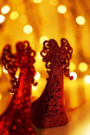 Red angel Christmas tree ornament, holiday background with defocus lights and decoration Stock Photo - 8267522