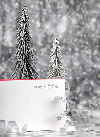 Happy holiday Christmas card background with blur lights, decoration & ornament photo