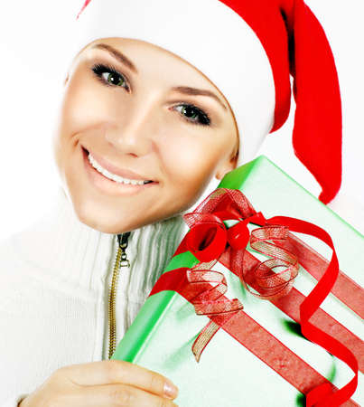Santa Claus girl closeup portrait, holding holiday present & gift box as Christmas & new year ornament decoration isolated on white background  photo