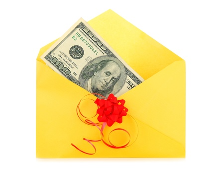 christmas profits: Money as a gift with red bow and yellow envelope