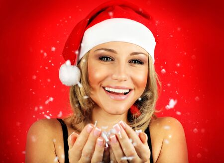 Portrait of pretty Santa girl laughing, isolated on red snowy winter holiday background Stock Photo - 8333698