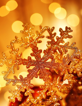 Snowflake background golden Christmas tree ornament and holiday decoration over abstract defocus lights Stock Photo - 8333709