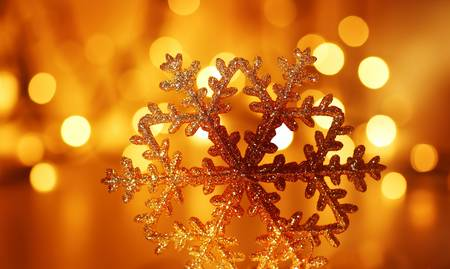 Snowflake background golden Christmas tree ornament and holiday decoration over abstract defocus lights Stock Photo - 8333707