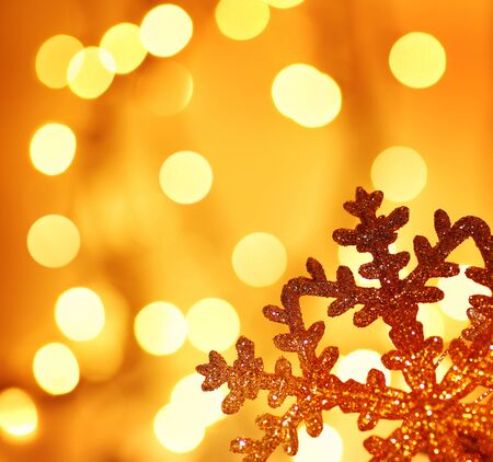 Snowflake background border golden Christmas tree ornament and holiday decoration over abstract defocus lights Stock Photo - 8333715