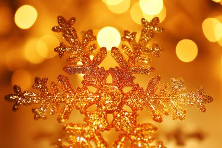 Snowflake background golden Christmas tree ornament and holiday decoration over abstract defocus lights Stock Photo - 8333717