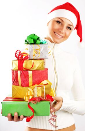 Santa Claus girl with colorful holiday presents & gift boxes as Christmas & new year ornament decoration isolated on white background with selective focus Stock Photo - 8333716