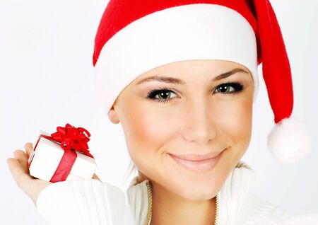 Pretty Santa girl closeup portrait, holding present gift box isolated on white background Stock Photo - 8333713