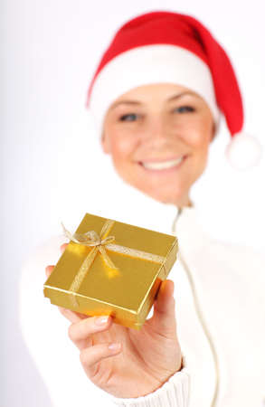Happy Santa girl with holiday present gift box as Christmas & new year ornament decoration isolated on white background with selective focus Stock Photo - 8375784