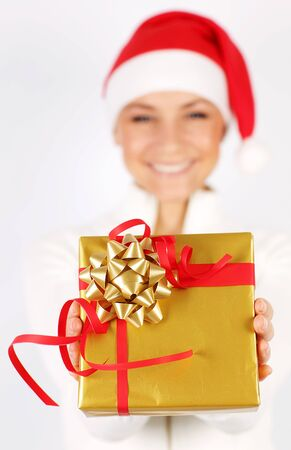 Happy Santa girl with holiday present gift box as Christmas & new year ornament decoration isolated on white background with selective focus photo