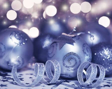 Holiday background with Christmas tree bauble ornament and star decoration over abstract defocus lights photo