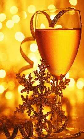new year eve: Romantic holiday drink, celebration of Christmas or new year eve, party with Champagne and festive gold ornament lights decoration