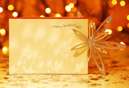 Beautiful gold happy Christmas card,winter holiday background, decoration postcard with snowflakes abstract over defocus lights photo