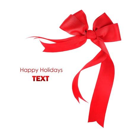 Beautiful red ribbon & bow, holiday border isolated on white background photo