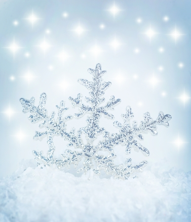 Beautiful blue snowflake winter holiday background photo