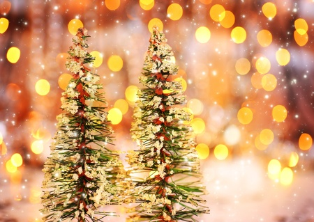 Christmas tree holiday background with winter ornament & abstract defocus lights decoration photo