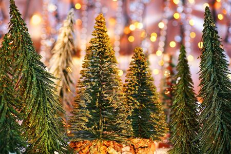Christmas tree forest, holiday background with winter ornament & abstract defocus lights decoration photo