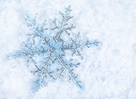 Beautiful blue snowflakes isolated on snow, winter holiday background Stock Photo - 8432390