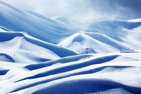 Winter mountain ski resort landscape with snow and chairlift photo