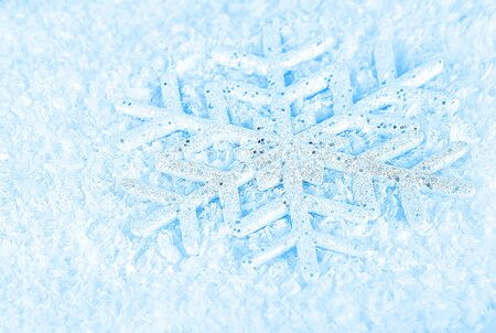 Snowflake, blue winter holiday background, christmas tree ornament & snow decoration photo