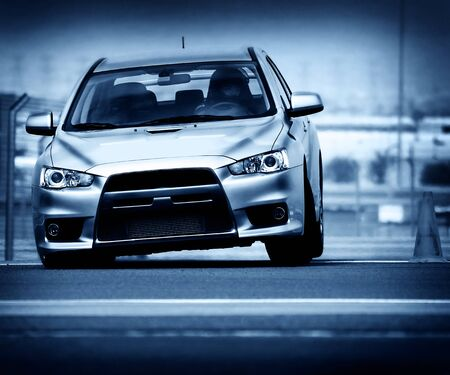Powerful sport car performing at car race championship Stock Photo - 8570604