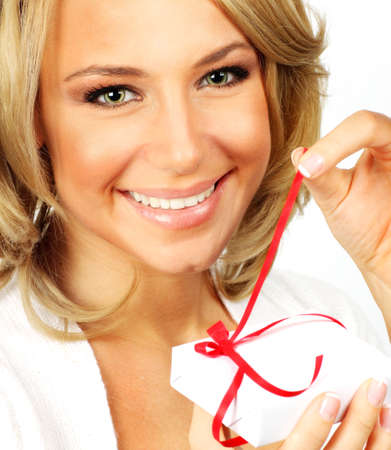 Beautiful female opening gift, closeup portrait isolated on white background photo