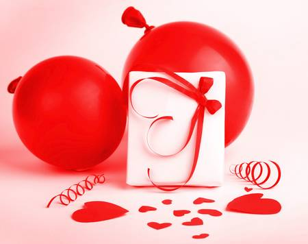 Gift box with red hearts & ribbon isolated on white background, conceptual image of love & Valentine's day holiday Stock Photo - 8620550